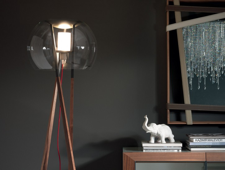 A clear glass lightshade and exposed electrical cord gives an industrial feel