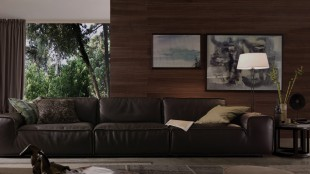 Dark brown leather couch and a multi-grain wood wall gives a luxurious feel to this living room