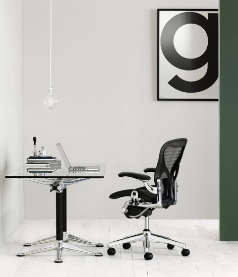 Black and white modern design with clean, straight lines and a glass top desk