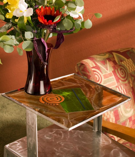 Stained glass and a metallic vase really shine in this end table setup