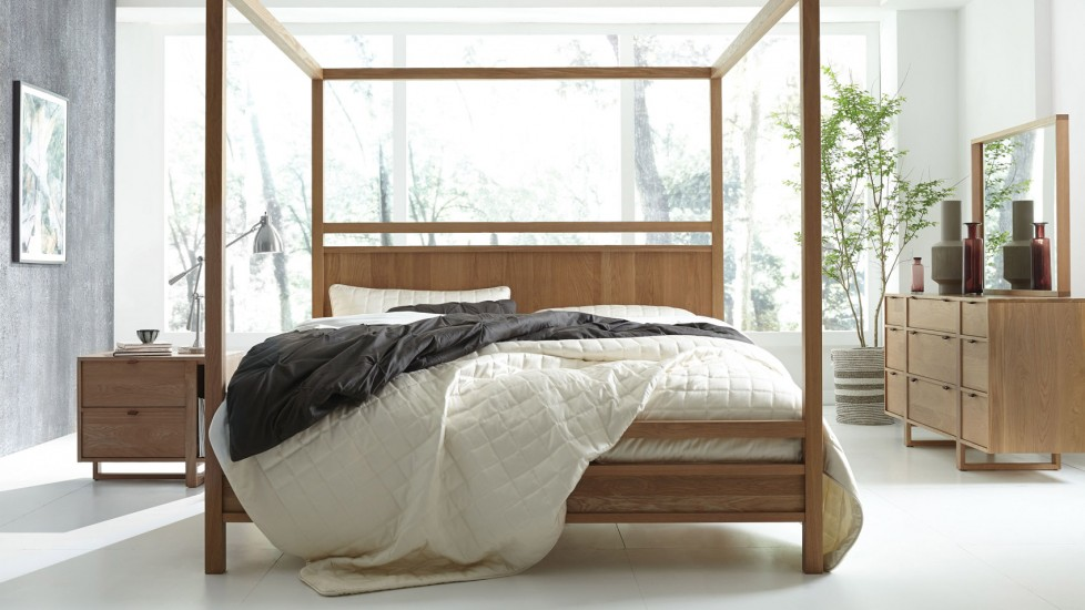All natural lighting and natural wood give this bedroom a very open concept
