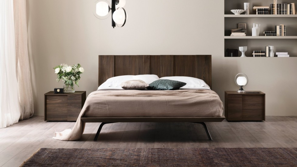 Unique light fixtures and neutral tones make for a luxurious bedroom