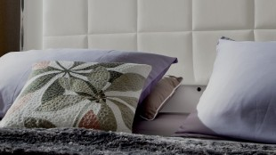 Textured fabric and bold design makes this throw pillow stand out