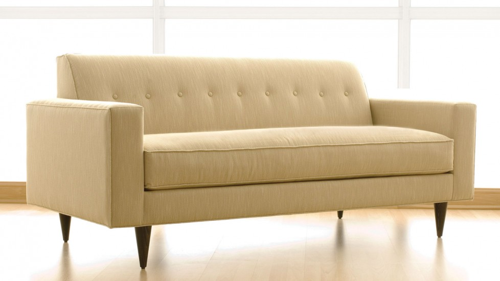 Soft beige fabric couch in natural lighting