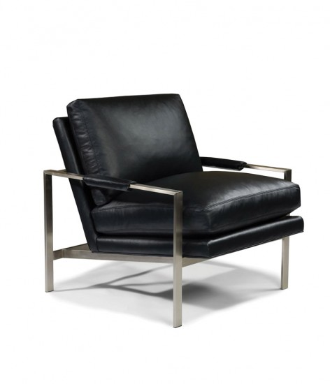 A black leather chair on a square metal frame