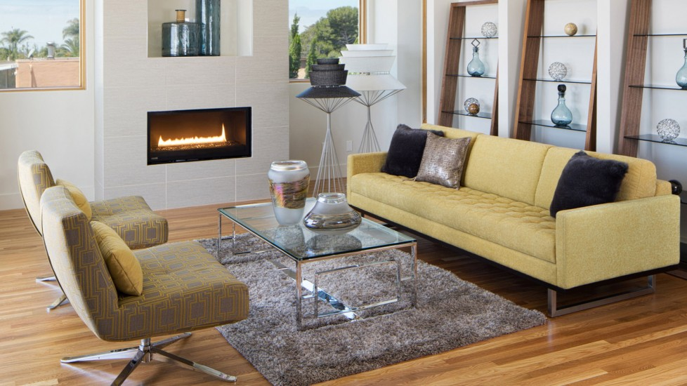 Clean lines, decorative vases, and a bold yellow couch combine for this luxury living room