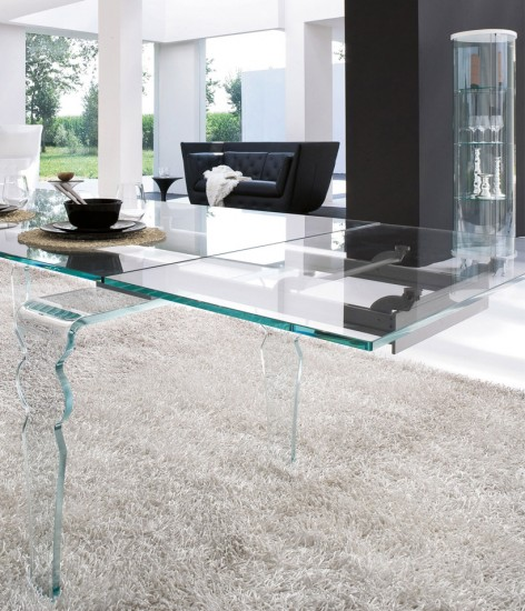 An all glass table, from the top to the legs - it's a conversation piece for any dining room