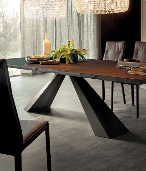 Triangle legs give a great illusion for this dining room table