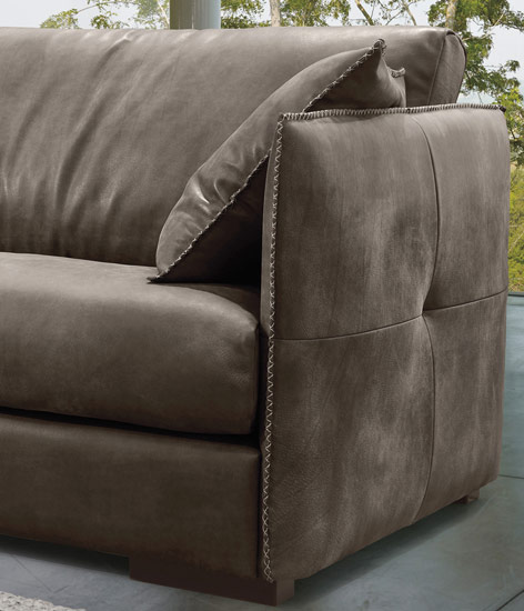 An all-brown suede couch screams comfortable lounging