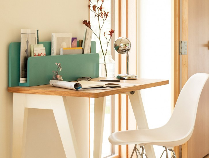 Small desk and short-backed chair give a work area that can fit anywhere