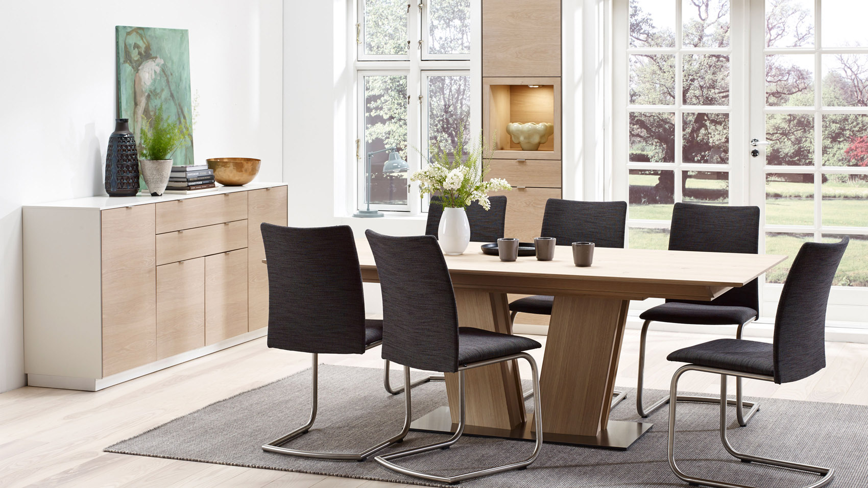 Dark Grey Fabric Chairs On Metal Frames Add Life To A Light Open Concept Dining