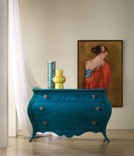 A unique deep blue wooden dresser gives a cartoon-inspired feeling